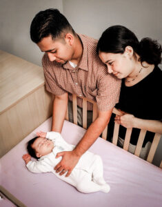Parents With Sleeping Baby